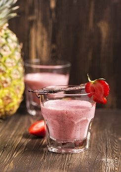Fresh healthy strawberry and pineapple smoothie with vanilla. Toned image