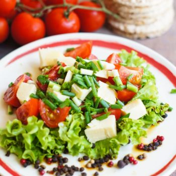 39731100 - healthy food, tomatoes and salad leaves with cheese and diet bread