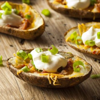 30916565 - homemade potato skins with bacon cheese and sour cream