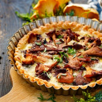 46018764 - quiche with chanterelle mushrooms and fresh savory